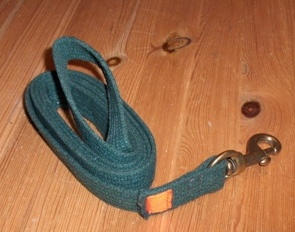 Strap or sling with a loop and brass snap hook